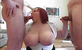 Huge titted Redhead in glasses get her chest covered in cum